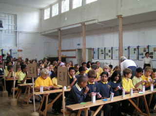 Children from the Wilshere Dacre school in the Lancasterian classroom