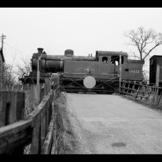 N7 tank engine with freight at Hill End Lane level crossing, eastern outskirts of St Albans, April 1960. | © Michael Covey-Crump