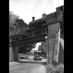 The bridge at Heath Park Halt, Hemel Hempstead, with Greenline bus and Phyllosan advertisement, 1957. | © Alan J Willmott
