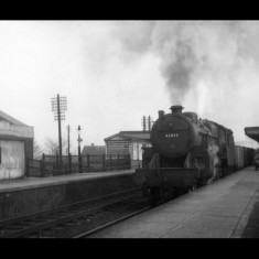 A Crab 2-6-0 locomotive, probably with coal freight, at Boxmoor Station, February 1961. | © Clive Kessell