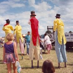 Stilt walkers amaze the children   Anne MacDonald