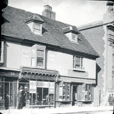 This shows two shops, Beard's men's outfitters and one owned by Mr Savage, cooper and basket-maker, on the other (west) side of the Corn Exchange that were demolished to make way for Market Street in about 1890. | Hertfordshire Archives and Local Studies/Mr Elsden