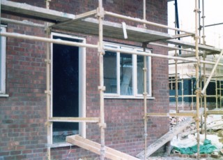 The brickwork has gone up and the windows are added. April 1983 | Susan Hall
