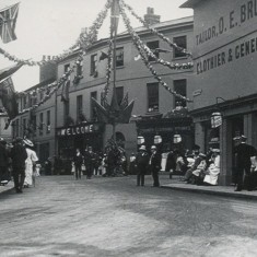 This is the other side of Fore Street viewed from Parliament Square. The building on the right (O. E. Bruton) is part of the block which was pulled down to make space for the war memorial. (We do not know the reason for the decorations.) | Hertfordshire Archives and Local Studies/Mr Elsden