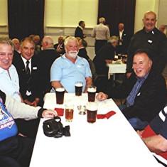(Left to right): Dennis Chapman, George Braddon, Ellis Webb, Bob Braddon, Walter Rough (standing), Melvyn Fox, Edward Braddon | Geoff Webb