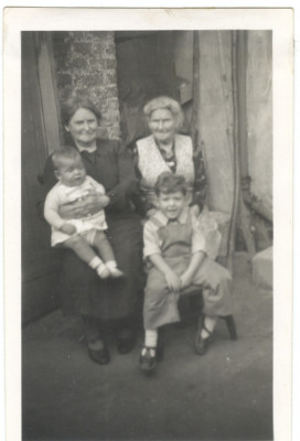 On the right, Annie Currell, born 1863 as Annie Bates in Hitchin. Annie was a Straw Plaiter. On the left holding me is my Nan, Annie Marie Currell, born 1889 at 'The Folly', Hitchin. Photograph taken early 1948 | Chris Allen