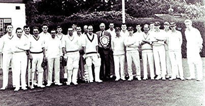 The Redbourn team is on the left hand side of the picture. Left to right: Bob Benn, John Luck, Geoff Webb, George Blair, Ron Walton, John Hobbs, Hugh Green, Harry Hobbs, David Torrey, Alan Batchelor. Tom Clarke (ex Surrey C.C.C.) is the umpire, Bryan Baxter and John Oliver is holding the shield. The Vauxhall C.C. team stands to the right hand side of the picture | Geoff Webb