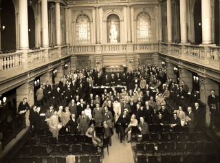 Conference delegates in Amsterdam, 1924. Howard is standing at the table in the centre | Hertfordshire Archives and Local Studies RefD/EHo/F29/24: