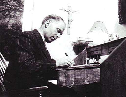 The Reverend Bickerton preparing his sermon at his writing table | Geoff Webb