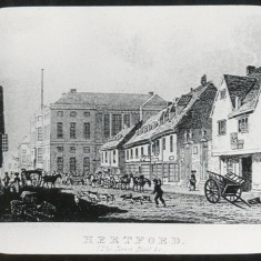 This engraving of Fore Street was published in 1823 by Sherwood & Co. The building on the far right is the Cross Keys Inn and next to it is the gaol which was later replaced by the two Corn Exchanges. You can see there is no clock on the Shire Hall at this time - it was added in 1824. Originally all animals brought to market were sold in this street. In 1851 a new market place was opened behind the Ram Inn. | Hertfordshire Archives and Local Studies/Mr Elsden