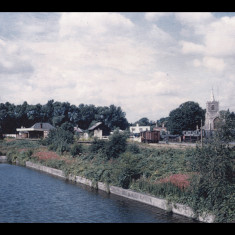 Rickmansworth Station and parish church, alongside the Grand Union Canal, 1962. | Photographer unknown, lent by Three Rivers Museum