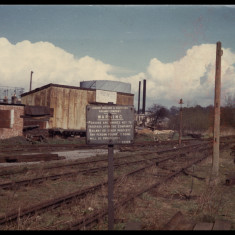 Siding near Rickmansworth Gasworks, with LMSR sign in 1962, fourteen years after nationalisation. | Photographer unknown, lent by Three Rivers Museum