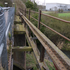 Railway bridge with dilapidated pedestrian section. The road bridge at Tolpits Lane. March 2010. | © St Albans Museums