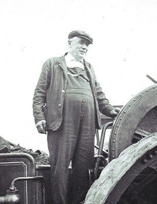 Frank Pratley at the wheel of his steam engine c.1936