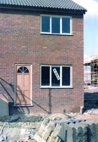 The front door is fitted so the house is water tight, April 1983 | Susan Hall