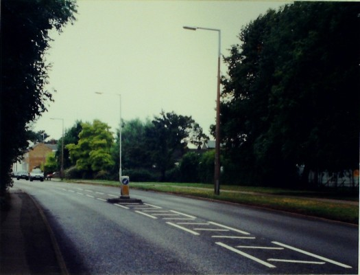 West side of Goffs Lane, a couple of shops are visible on the left. Brynfields Nursery is behind the trees on the right. 2000 | Iain Bickerton