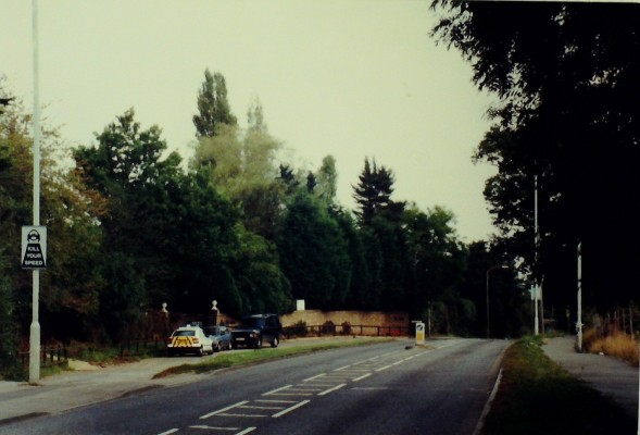 The cars stand on the original Goffs Lane, before it was straightened and widened. The 'Old Barn' bed and breakfast hotel, built in the early 1930s, is located behind the cars. The footpath on the right was put down in 2000. Photo September 2000 | Iain Bickerton