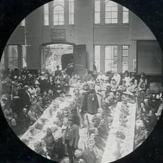 A dinner given for the old people of Hertford to celebrate Queen Victoria's Golden Jubilee in 1887. It appears to have been held in the Corn Exchange; this would be before the stage was put in. The open space visible through the windows at the end would be where the Beadle's office, and the covered market, were built - and later demolished to give way to shops and offices | Hertfordshire Archives & Local Studies (photo: Mr Elsden)