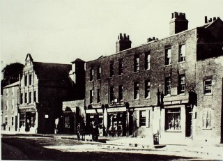 West side of High Street, date not known. The upper floors were family homes | Hertfordshire Archives & Local Studies