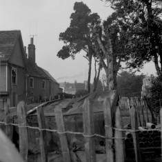 View towards the churchyard from West Street showing Jaggs the bakers on the left | HALS (ref HrtCpl_0150_05_02)