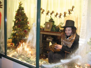 A Dickensian Christmas scene in the window of the Isobel Hospice shop