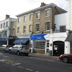 The building remains much the same in 2010 and now houses Jenner's Newsagent and Stowaway Travel. | Fiona MacDonald