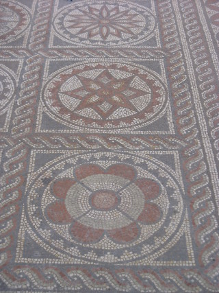 Geometric and 'flower' designs are typical of Verulamium mosaics