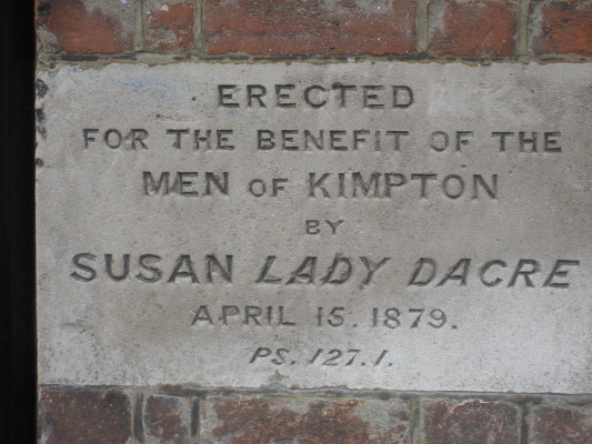 A plaque in the wall of the Dacre Rooms, in the High Street