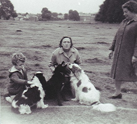 Betty Mardell (kneeling) with Edie Fox, their three affectionate dogs on the common. | Geoff Webb
