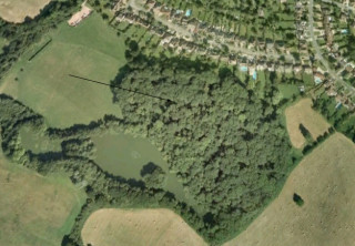 Ariel photograph with arrow indicating the approximate location of More Hall - Today part of Gobions Woodland Trust