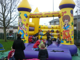 The bouncy castle was very popular for young children.