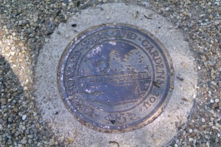 Plaque in footpath commemorates reopening | John Birch