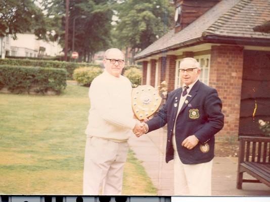 Bill Langham receiving a trophy