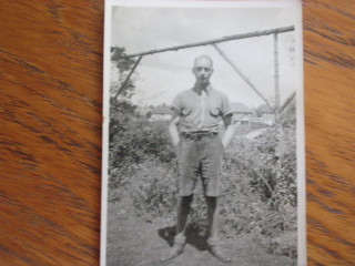 Doug Gifford in the garden of 168 Icknield way.  In the background is 22 Bedford Road partially built  so 1935-6 | Mark Gifford