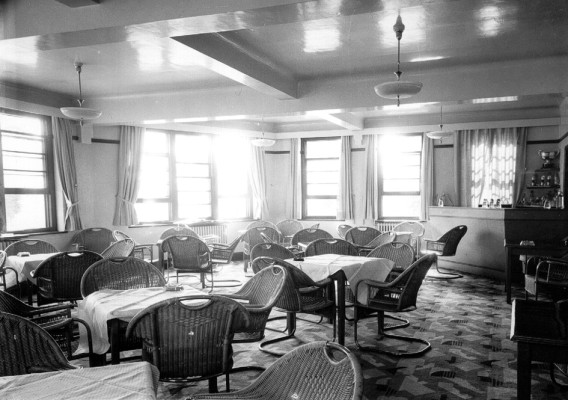 Interior of the clubroom at the Golf Club clubhouse, 1937. The chairs came from an ocean liner. | First Garden City Heritage Museum (not to be reproduced without permission)