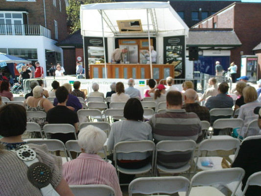 Audience watch cookery demonstration