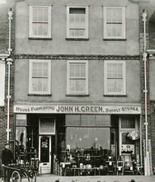 John H. Green Home Furnishings shop, c. 1910. John H. Green offered themselves as a