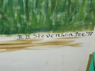 The artist's signature on the painting
