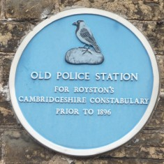 OLD POLICE STATION: An odd-shaped building that many believe is on the site of the entrance to the dog kennels of King James' Hunt. For many years land to the north of the Cross was in the county of Cambridgeshire until boundary changes initiated by an Act of Parliament, so up to 1896 Royston had two police forces; one for each county. The Hertfordshire Police Station was built in the 1880s on the corner of Priory Lane and Market Hill and incorporated a Magistrates Court and lock-ups, still in existence today. | Tim Shepherd
