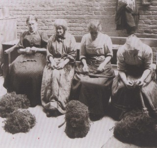 Women in a workhouse picking oakum