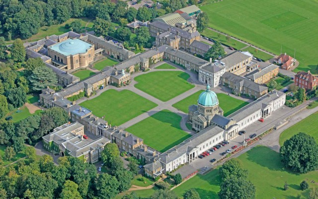 Areal view of the quad as it is today with chapel in the foreground, Big School on the right of the quad and the Dining Hall in the background | Haileybury College