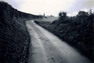 Eerie, winding Rectory Lane | Nicholas Connell