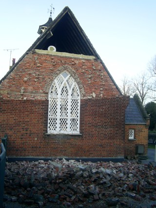 End view of the school building and collapsed wall | St Michael's Woolmer Green School
