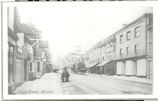 The High Street, looking towards the Market Square.Perks and LLewellyn's storefront is on the right.