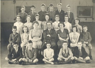 Eleven plus students at Wilshere Dacre School, 1943? Can you recognise any members of the class?