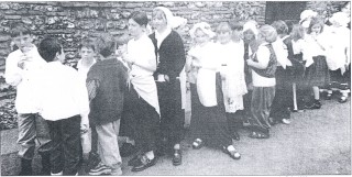 Modern photo of students at Wareside dressed like their Victorian predecessors of the school 1999 | Hertfordshire Archives and Local Studies