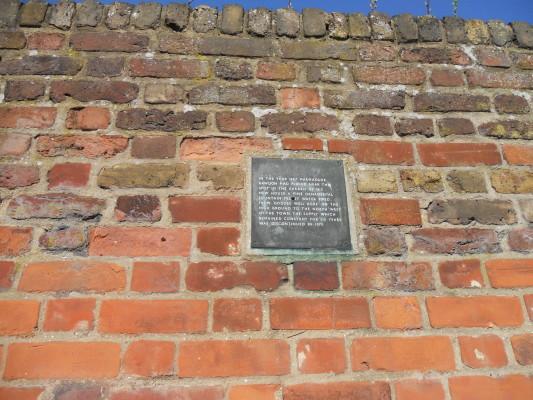 Plaque outside The Grange   Gladys Lardi