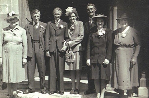 Left to right: Minnie Tibbs, Fred Coote, groom and bride, Fred Heley, Marjorie Heley (front), Florrie Heley. | Geoff Webb