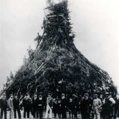 Queen Victoria's Diamond Jubilee bonfire in Watford, 1897. Standing (left to right): Mr Marcus Boff, Mr Waterhouse, Mr H. Camp, Mr F. Fisher, Mr Charles Brightman, Mr E. J. Slinn, Mr C. P. Ayres, Mr James Darvill, Mr George Capell, Mr Clifford, Mr Andrews, Mr E. J. Jackson and M. W. Tearl | Hertfordshire Archives & Local Studies
