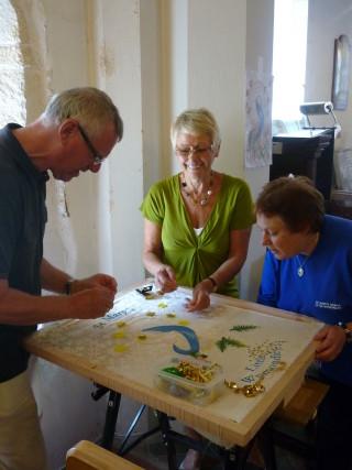 Adding a stitch to the banner at Little Wymondley Church | Ann L